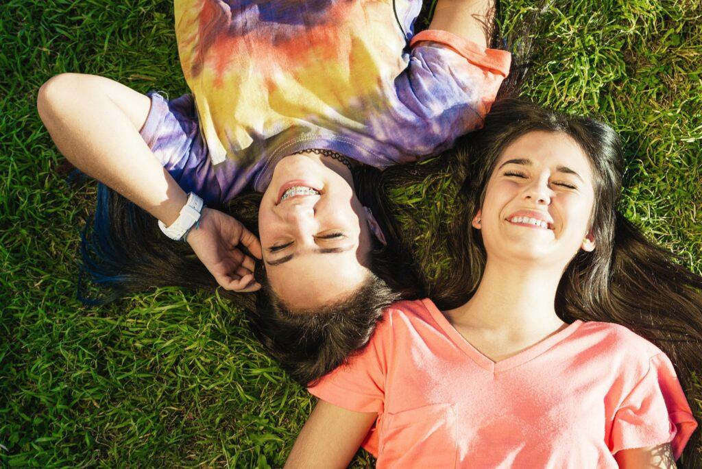 Beautiful Teenage Girls Having Fun in Summer Park. Outdoor